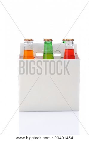 Side view of a six pack of assorted soda bottles over a white background with reflection.