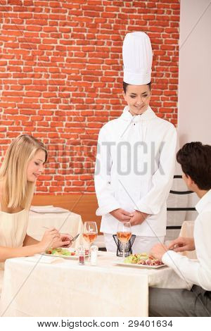 Couple complimenting the chef on her cooking