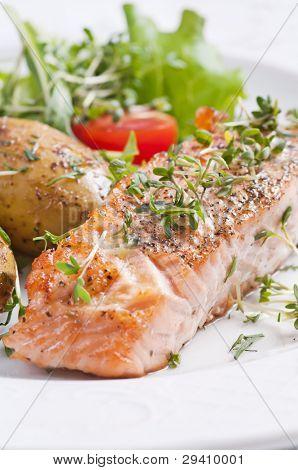 Roasted salmon steak with jacket potato