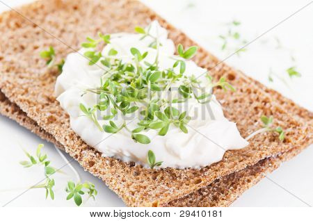 crispbread with fresh cheese and cress