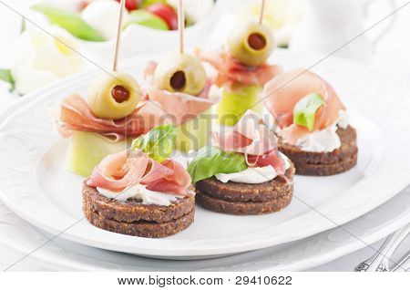 canapes with ham and olives