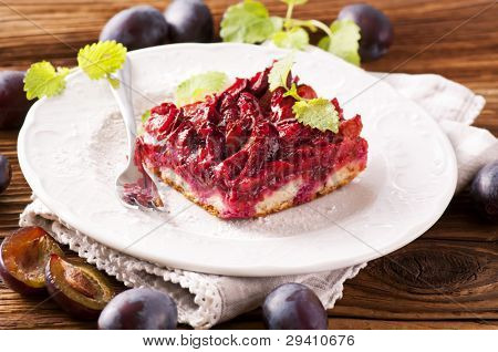 Plum cake zwetschgendatschi on wooden table