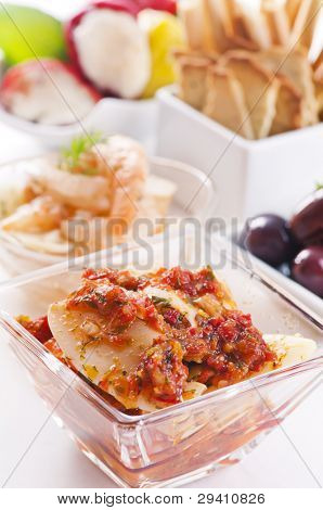 Tapas with pickled seafood and olives