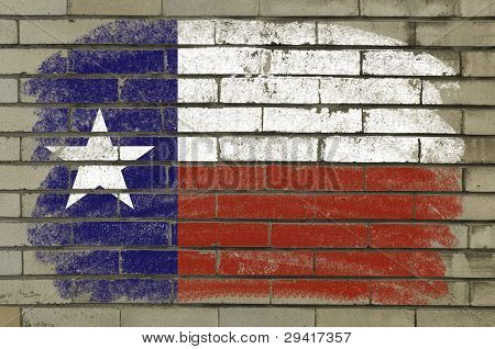 Grunge Flag Of Us State Of Texas On Brick Wall Painted With Chalk