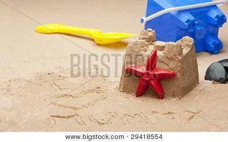 Childs Sandcastle On Beach.