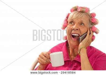 Happy, Surprised  Lady In Curlers On Cell Phone