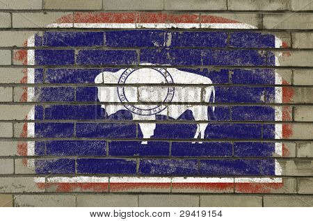 Flag Of Us State Of Wyoming On Brick Wall Painted With Chalk