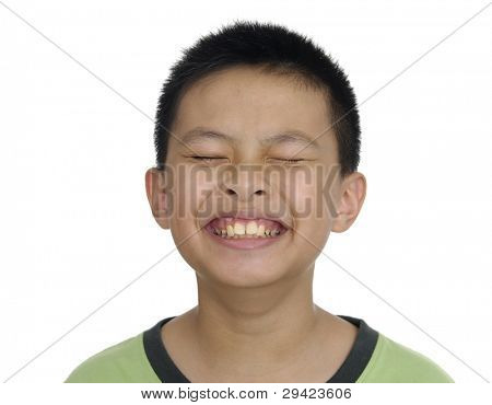 Happy boy laughing with milk mustache isolated.