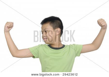 Little strong boy showing his muscles isolated against white background