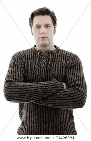 Man In A Woolen Sweater With Arms Crossed. Isolated On White.