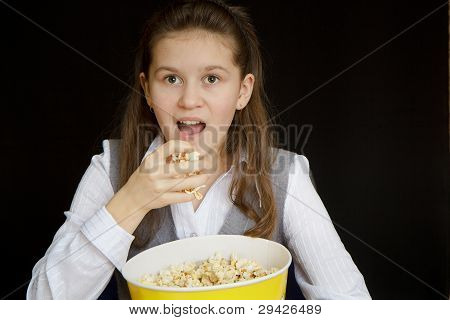 Surprised Girl With Popcorn On A Black Background