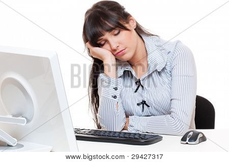 tired businesswoman sleeping on her workplace