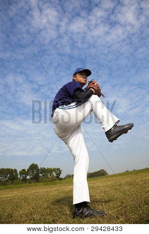 baseball pitcher in the green field pitch