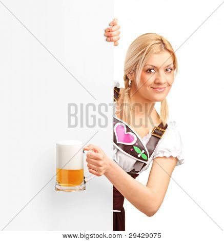 German girl holding a pint of beer behind a blank billboard, isolated on white background