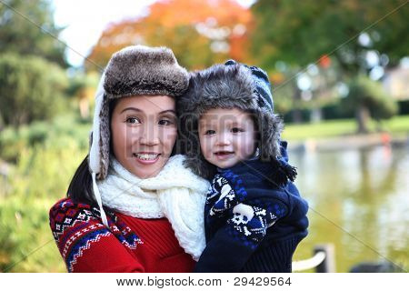 An attractive mother and son in park during the winter season