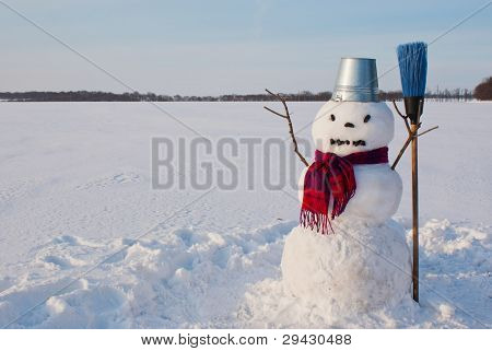 Lonely Snowman At A Snowy Field