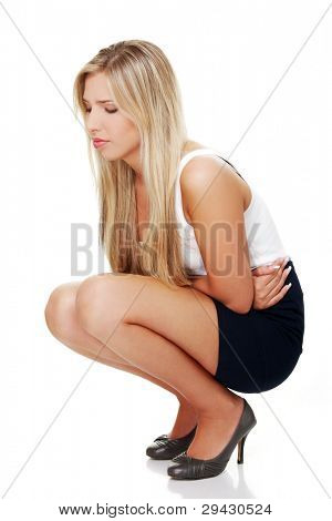 Young business woman with stomach issues. Isolated on white