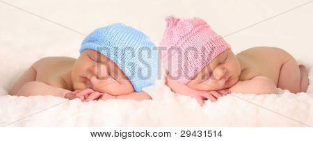 Newborn baby girl and boy twins.