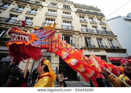 FRANCE, PARIS - JANUARY 28: Unidentified participants celebrate dragon Chinese New 2012 Year pass by the Hotel de Ville in Paris, France on January 28, 2012.