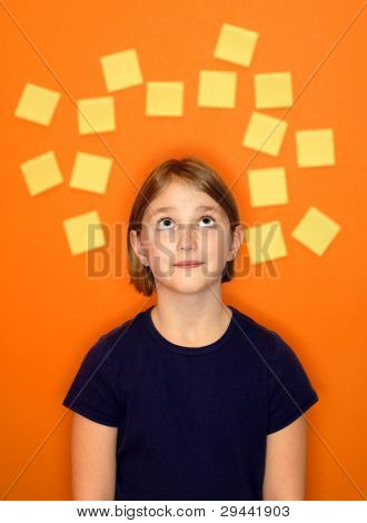 Young girl with sticky notes around her head representing her thoughts