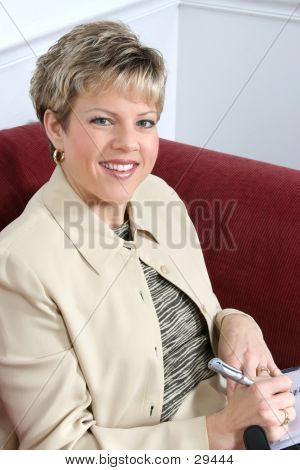 Close Up Business Woman With Date Book