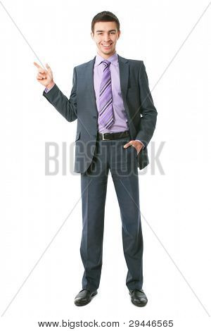 Attractive business man pointing at copyspace