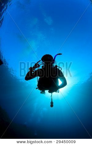 Scuba Diver silhouette against sunburst