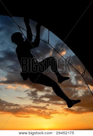 silhouette climber in sunset