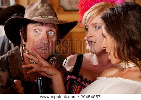 Surprised Cowboy And Two Lovely Women