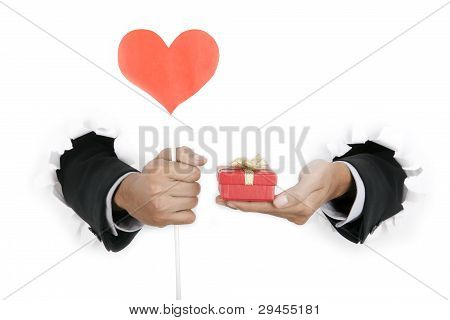 Businessman's Hand Holding Gift And Heart Shape