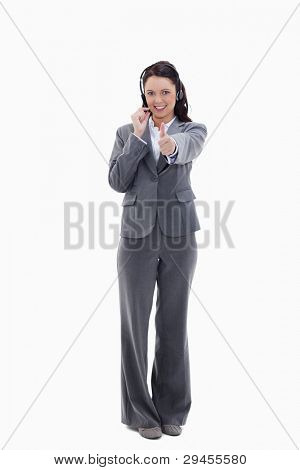 Businesswoman approving with a headset against white background