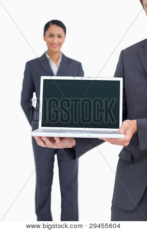 Close up of laptop being presented by salesteam against a white background