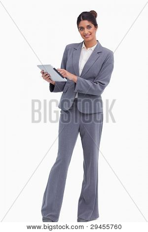 Smiling female entrepreneur with her tablet computer against a white background