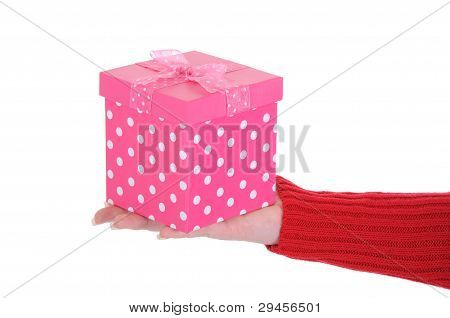 Female Hand Holding A Pink Gift Box