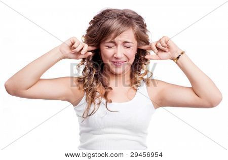 portrait of an angry young woman closing her ears and refusing to listen to something , isolated against purple studio background