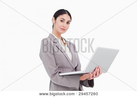 Side view of businesswoman with laptop against a white background