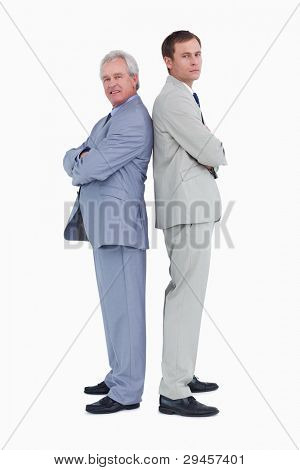 Side view of tradesmen standing back to back against a white background