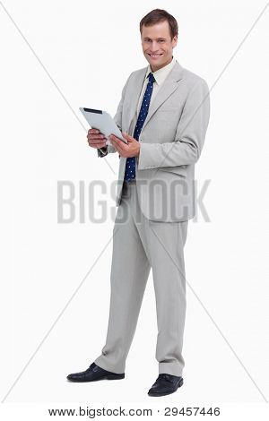Smiling businessman with his tablet computer against a white background