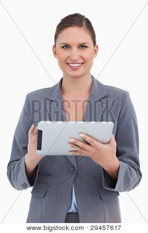 Smiling tradeswoman with her touchscreen computer against a white background