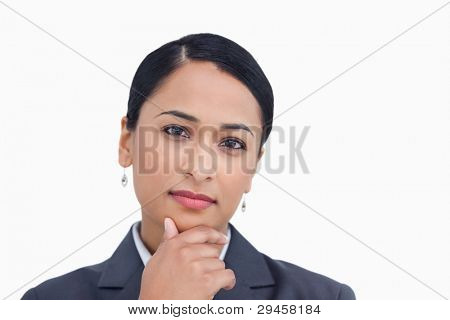 Close up of saleswoman in thinkers pose against a white background