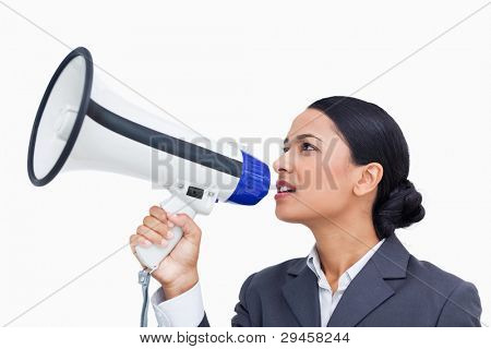 Close up side view of saleswoman using megaphone against a white background