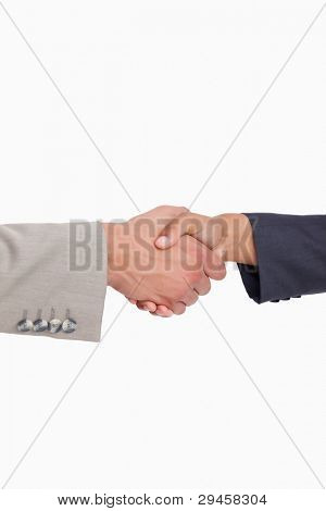 Side view of shaking hands of business people against a white background