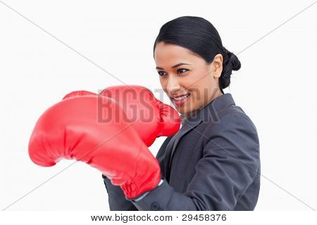 Close up side view of saleswoman with boxing gloves against a white background
