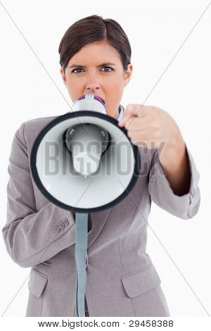 Close up of angry yelling entrepreneur with megaphone against a white background