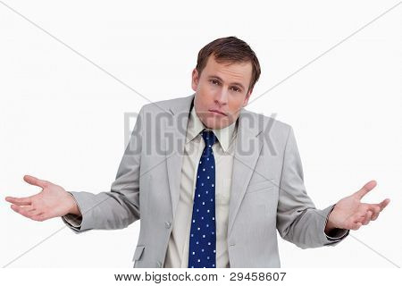 Close up of clueless businessman against a white background