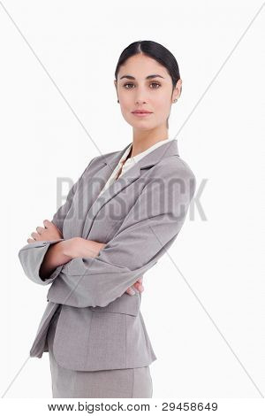 Side view of businesswoman with folded arms against a white background