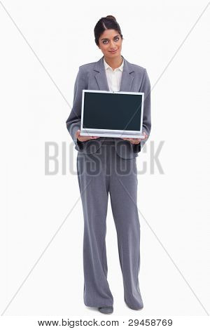 Female entrepreneur presenting screen of her laptop against a white background