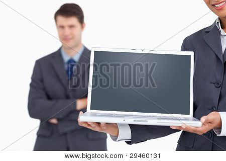 Close up of notebook screen being presented by salesteam against a white background