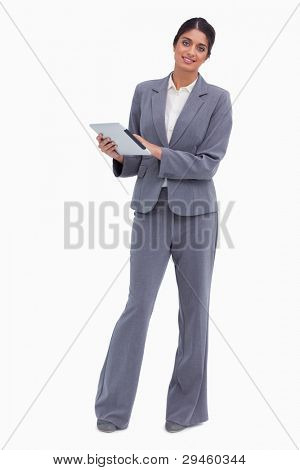 Smiling female entrepreneur with tablet computer against a white background