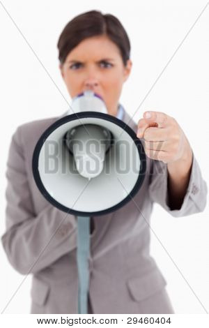 Close up of megaphone being used by angry entrepreneur against a white background